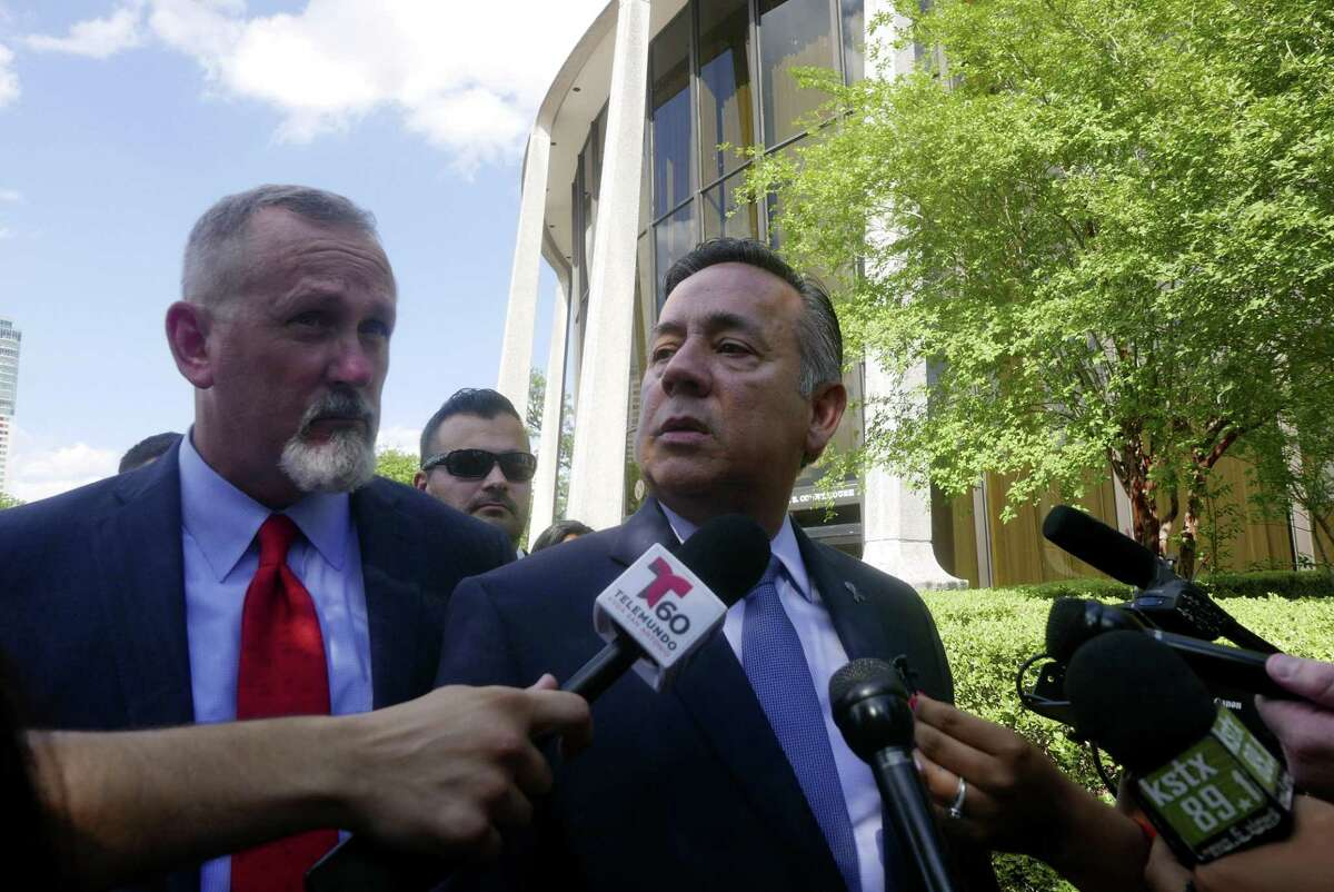 State Sen. Carlos Uresti, right, speaks as he stands with his lawyer, Mike McCrum after leaving the San Antonio federal courthouse after being sentenced for his criminal conviction in the FourWinds Logistics case on June 26. A reader is outraged that Uresti wants his pension.