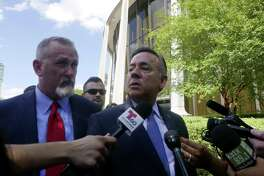 A judge denied ex-lawmaker Carlos Uresti's request to appoint San Antonio lawyer Michael McCrum, left, to represent him in the appeal of his conviction in a fraud case. Uresti and McCrum are pictured June 26 leaving the San Antonio federal courthouse following Uresti's sentencing.