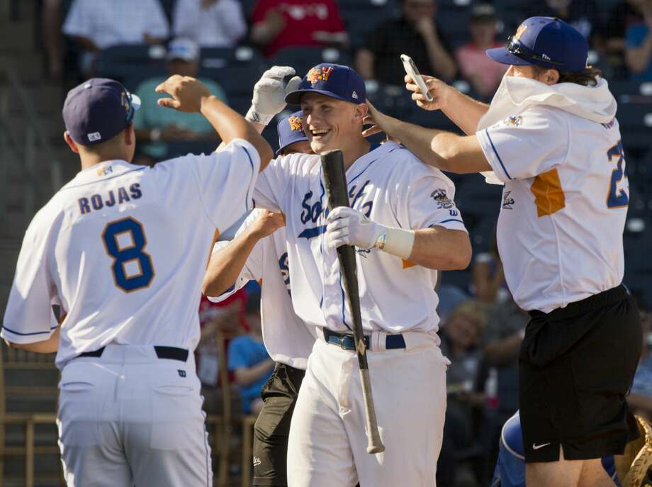 The RockHounds' Sean Murphy is congratulated by his South teammates after he knocked 8 home runs to win the home run derby 06/26/18 before the Texas League All-Star Game at Security Bank Ballpark. Tim Fischer/Reporter-Telegram Photo: Tim Fischer/Midland Reporter-Telegram