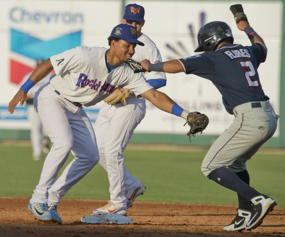 RockHounds' Richie Martin tries to put the tag on North's Jecksson Flores as he tries to steal second and gets caught in a run down back to first 06/26/18 at the Texas League All-Star Game at Security Bank Ballpark. Tim Fischer/Reporter-Telegram Photo: Tim Fischer/Midland Reporter-Telegram