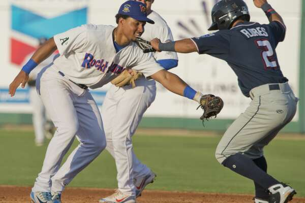 RockHounds' Richie Martin tries to put the tag on North's Jecksson Flores as he tries to steal second and gets caught in a run down back to first 06/26/18 at the Texas League All-Star Game at Security Bank Ballpark. Tim Fischer/Reporter-Telegram