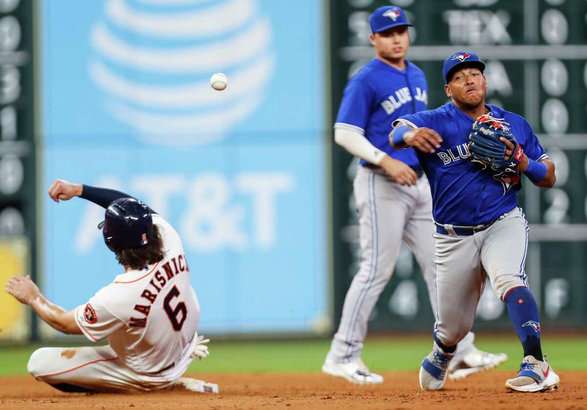 Toronto Blue Jays third baseman Yangervis Solarte (26) turns a double play on a grounder by Houston Astros catcher Brian McCann, forcing out Jake Marisnick at second, during the sixth inning of a major league baseball game at Minute Maid Park on Tuesday, June 26, 2018, in Houston.