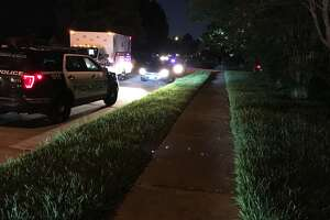 An armed suspect who climbed on the roof of an off-duty deputy's home was shot at by the deputy and soon taken into custory, Harris County authorities said Tuesday night.