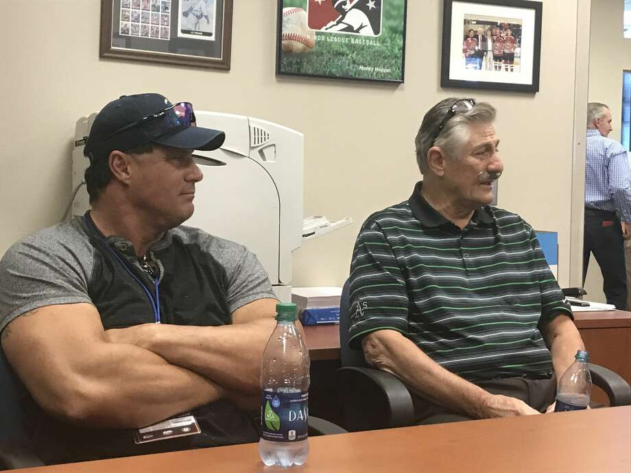 Oakland Athletics greats Jose Canseco, left, and Rollie Fingers meet with the media during Tuesday's Texas League All-Star Game at Security Bank Ballpark. Photo: Christopher Hadorn