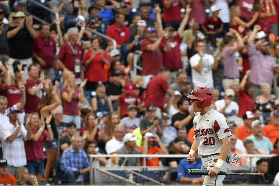 Carson Shaddy of Arkansas celebrates after scoring during the Razorbacks' four-run rally in the fifth inning Tuesday. Arkansas beat Oregon State 4-1 in Game 1 of the College World Series. Photo: Ted Kirk / Associated Press