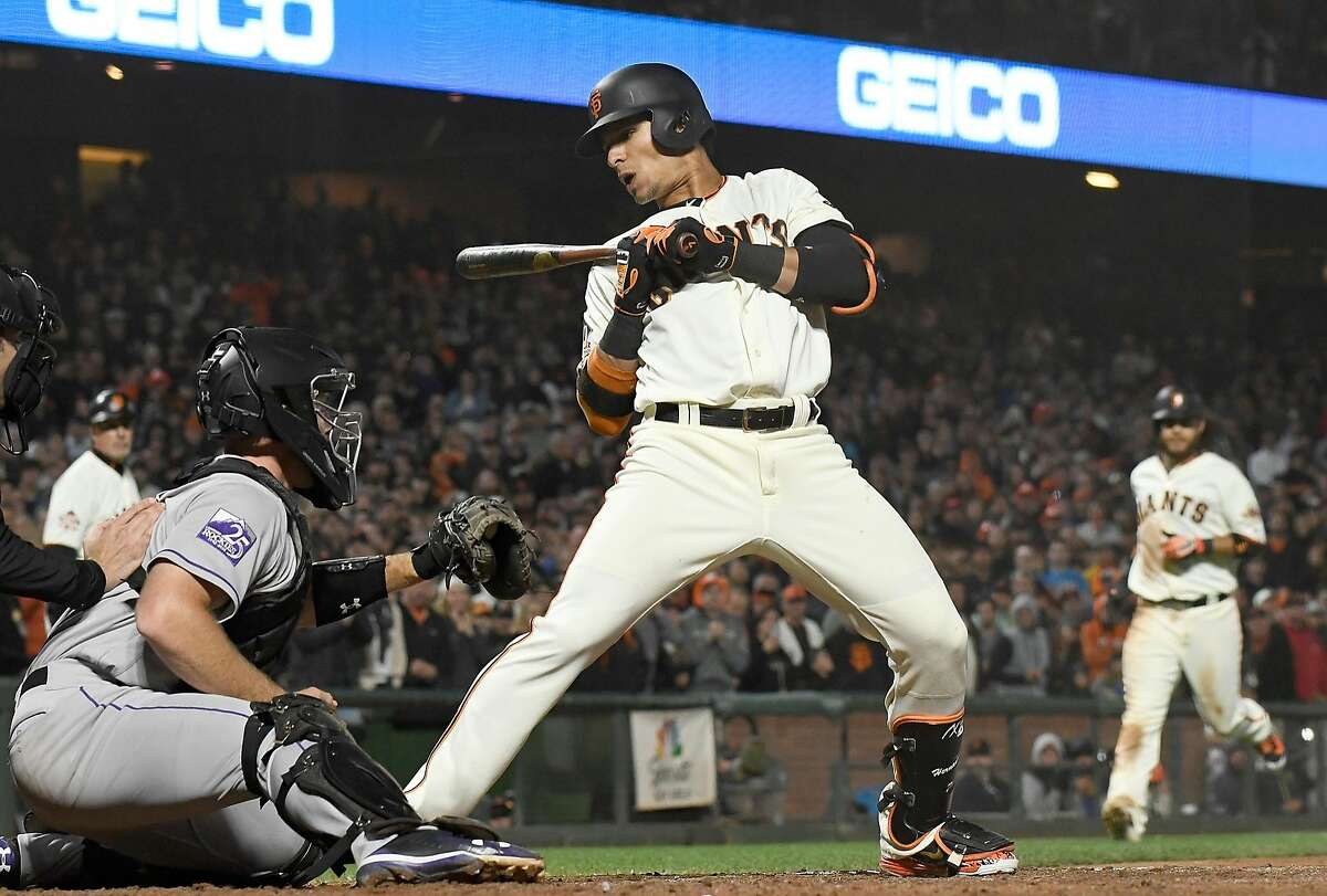 SAN FRANCISCO, CA - JUNE 26: Gorkys Hernandez #7 of the San Francisco Giants leans back out of he way of ball four forcing in Brandon Crawford #35 with the go ahead run against the Colorado Rockies in the bottom of the eighth inning at AT&T Park on June 26, 2018 in San Francisco, California. (Photo by Thearon W. Henderson/Getty Images)