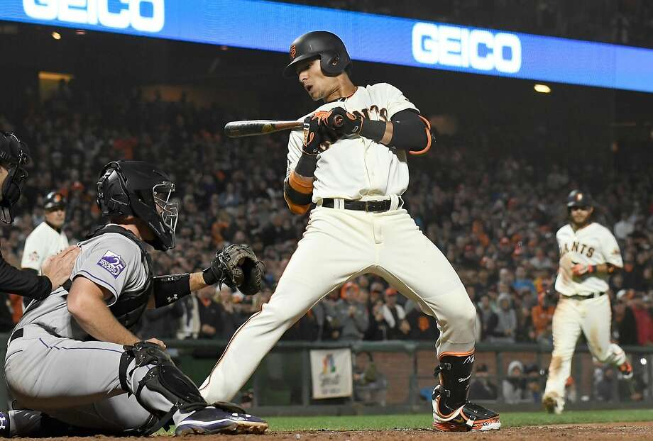 SAN FRANCISCO, CA - JUNE 26:  Gorkys Hernandez #7 of the San Francisco Giants leans back out of he way of ball four forcing in Brandon Crawford #35 with the go ahead run against the Colorado Rockies in the bottom of the eighth inning at AT&T Park on June 26, 2018 in San Francisco, California.  (Photo by Thearon W. Henderson/Getty Images) Photo: Thearon W. Henderson / Getty Images