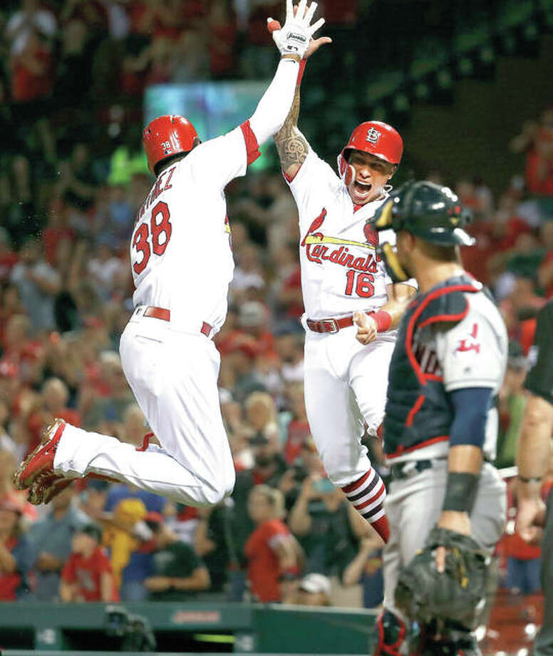 Cardinals Jose Martinez (38) and Kolten Wong (16) celebrate a three-run homer by Martinez as Indians catcher Yan Gomes, right, watches in the second inning of Tuesday night's game in St. Louis. Photo:     Jeff Roberson | AP Photo