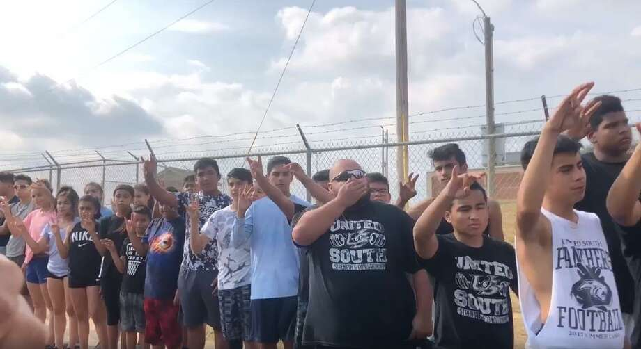 This screenshot from a video shows students, colleagues and friends of Rolando Ramos lining the street as the funeral procession made its way along United South middle and high schools. Photo: Courtesy Photo