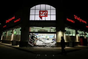 Employees of a Walgreens store at FM-1093 and Wilcrest Drive wait for the clean-up crew to arrive after an overnight ATM smash and grab at the store on Wednesday, June 27, 2018, in Houston.