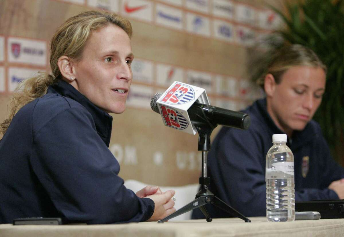 United States women's national soccer team Kristine Lilly, left, and forward Abby Wambach answer questions during a press conference Saturday, Sept. 29, 2007 in Shanghai. Lilly discussed the team's decision to exclude goal keeper Hope Solo from the last training session and from Sunday's third place match against Norway in the consolation match of the FIFA 2007 Women's World Cup soccer tournament on Sunday. Solo publicly questioned coach Greg Ryan's decision to play keeper Briana Scurry against Brazil in the semi final match. (AP Photo/Julie Jacobson)