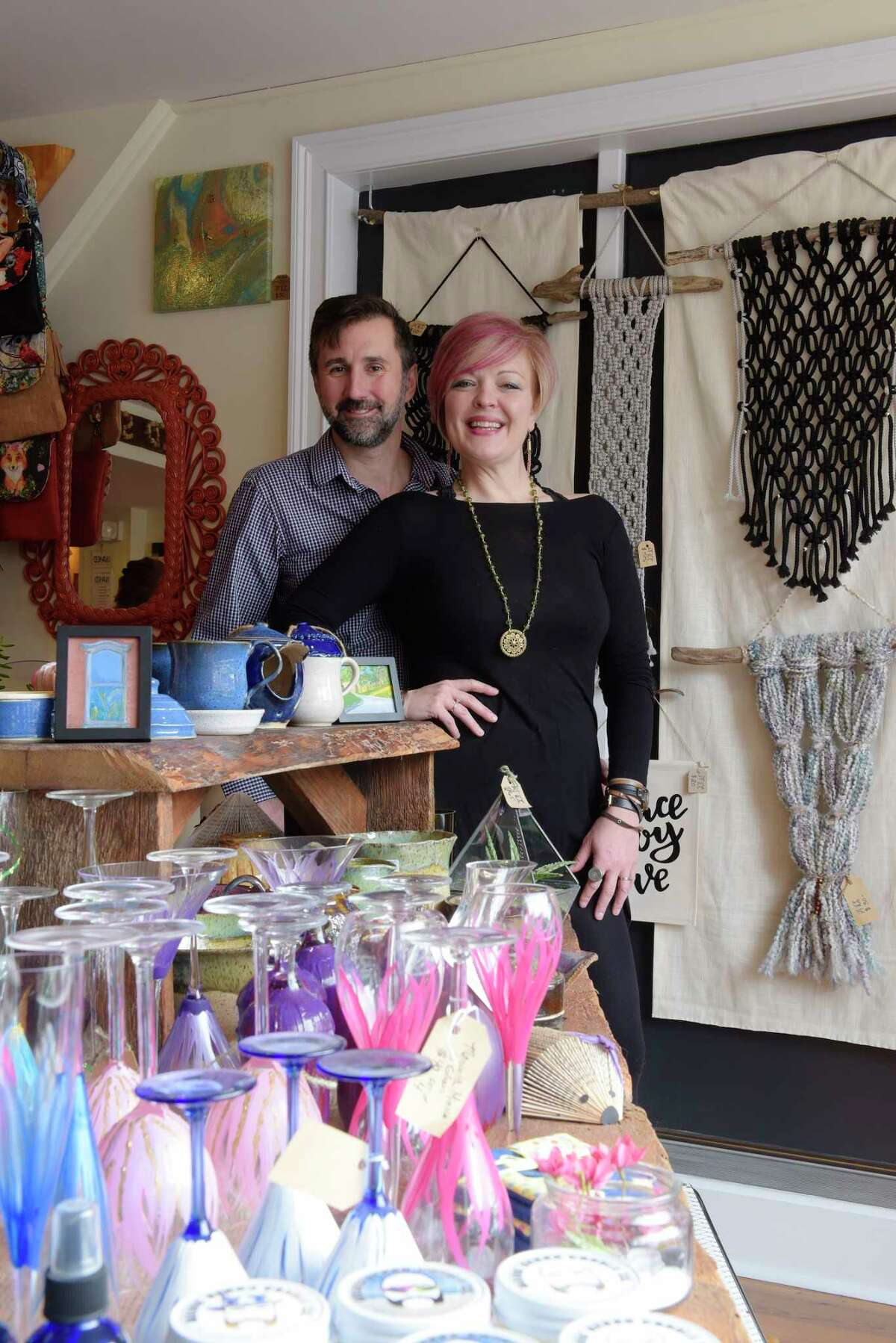 Carrie VanDerhoof and her husband, Greg Wichser, pose inside their store, Boho Chic, on Monday, April 30, 2018, in Ballston Spa, N.Y. (Paul Buckowski/Times Union)