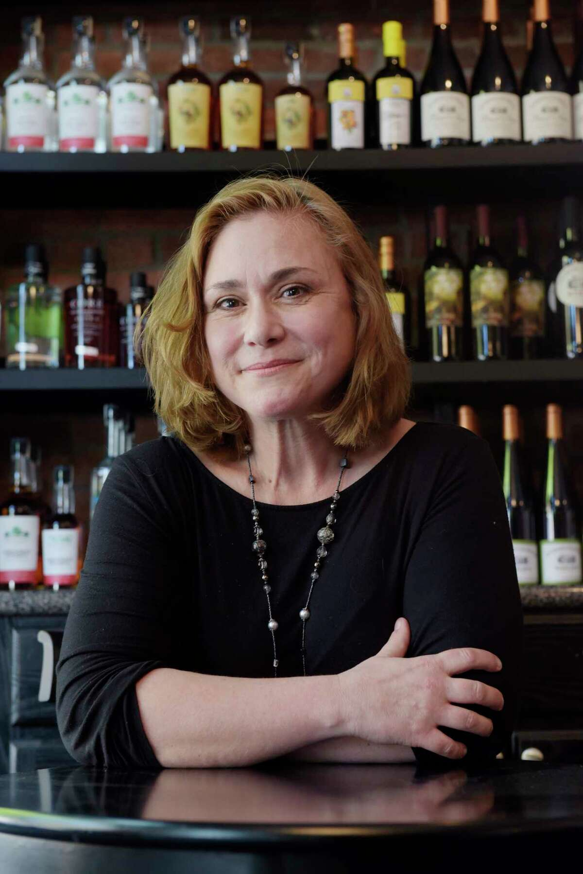 Kathleen Weber, owner of Northern Cross Vineyard, poses for a photo at the Hudson-Chatham Winery tasting room on Thursday, May 24, 2018, in Troy, N.Y. (Paul Buckowski/Times Union)