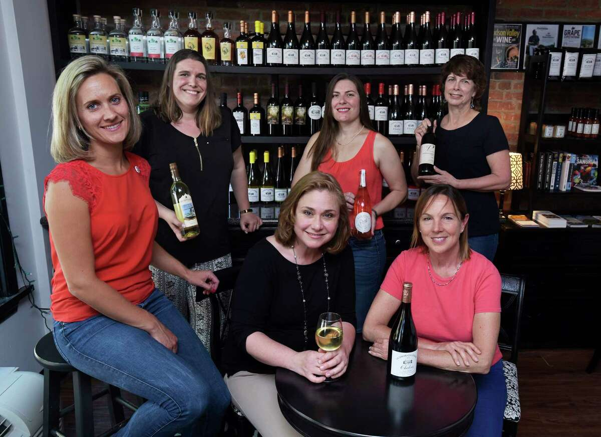 Foreground from left to right, Kimberly Peacock, owner of Tousey Winery, Kathleen Weber, owner of Northern Cross Vineyard, Dominique DeVito, owner of the Hudson-Chatham Winery, background from left to right, Sasha Pardy, owner of Adirondack Winery, Kate Taylor, owner of Galway Rock Vineyard and Winery and Saratoga Sparkling Company, and Mary Barnhart, owner of Victory View Vineyard, pose for a photo at the Hudson-Chatham Winery tasting room on Thursday, May 24, 2018, in Troy, N.Y. (Paul Buckowski/Times Union)