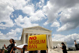 People protest against the Supreme Court ruling upholding President Donald Trump's travel ban outside the the Supreme Court in Washington. (AP Photo/Jacquelyn Martin)