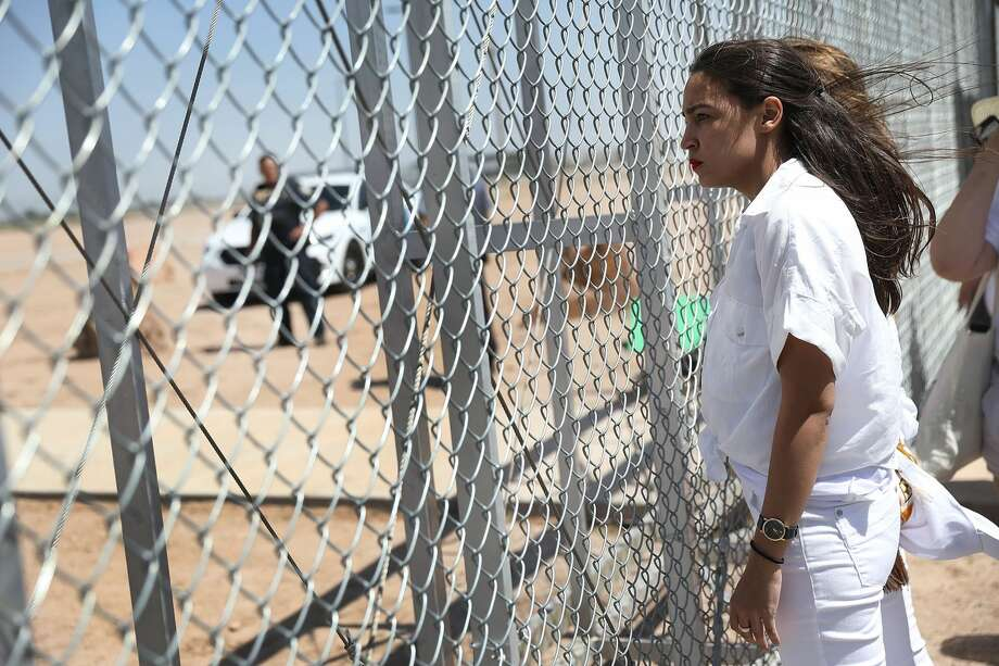 Alexandria Ocasio-Cortez stands at the Tornillo-Guadalupe port of entry gate on June 24, 2018 in Tornillo, Texas. She is part of a group protesting the separation of children from their parents after they were caught entering the U.S. under the administration's zero tolerance policy. Photo: Joe Raedle/Getty Images