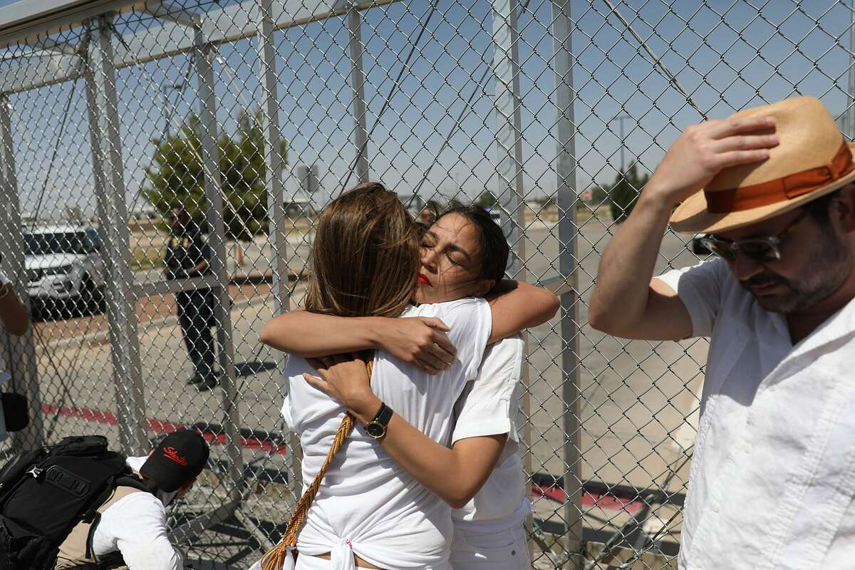TORNILLO, TX - JUNE 24: Alexandria Ocasio-Cortez is embraced at the Tornillo-Guadalupe port of entry gate on June 24, 2018 in Tornillo, Texas. She is part of a group protesting the separation of children from their parents after they were caught entering the U.S. under the administration's zero tolerance policy. (Photo by Joe Raedle/Getty Images)