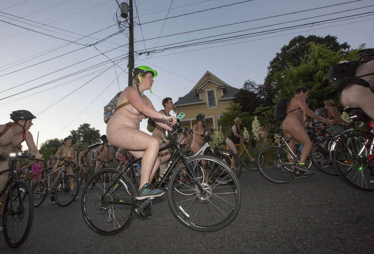 PORTLAND, OR - JUNE 23: (EDITORS NOTE: Image contains nudity.) Cyclists take part in the annual