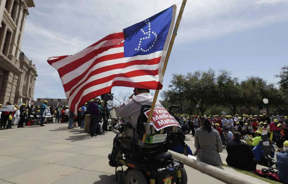 In 2013, protesters marched on the Texas capitol demanding lawmakers expand Medicaid to include an additional 1.5 million poor people. That didn't happen and now the federal government is encouraging states to set work requirements on certain Medicaid recipients. Photo: Eric Gay /AP / AP