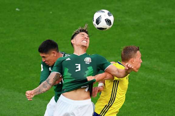 Mexico's defender Carlos Salcedo (C) heads the ball during the Russia 2018 World Cup Group F football match between Mexico and Sweden at the Ekaterinburg Arena in Ekaterinburg on June 27, 2018. / AFP PHOTO / JORGE GUERRERO / RESTRICTED TO EDITORIAL USE - NO MOBILE PUSH ALERTS/DOWNLOADSJORGE GUERRERO/AFP/Getty Images
