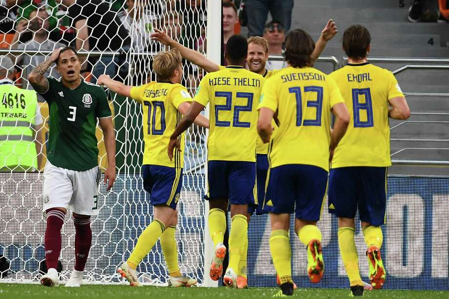 Sweden's players celebrate after Mexico's defender Edson Alvarez scored an own goal during the Russia 2018 World Cup Group F football match between Mexico and Sweden at the Ekaterinburg Arena in Ekaterinburg on June 27, 2018. / AFP PHOTO / Anne-Christine POUJOULAT / RESTRICTED TO EDITORIAL USE - NO MOBILE PUSH ALERTS/DOWNLOADSANNE-CHRISTINE POUJOULAT/AFP/Getty Images Photo: ANNE-CHRISTINE POUJOULAT, AFP/Getty Images / AFP or licensors