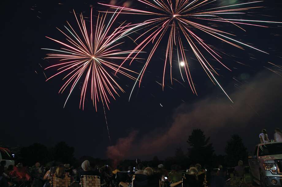 Fireworks explode over the American Legion golf course during a previous display.