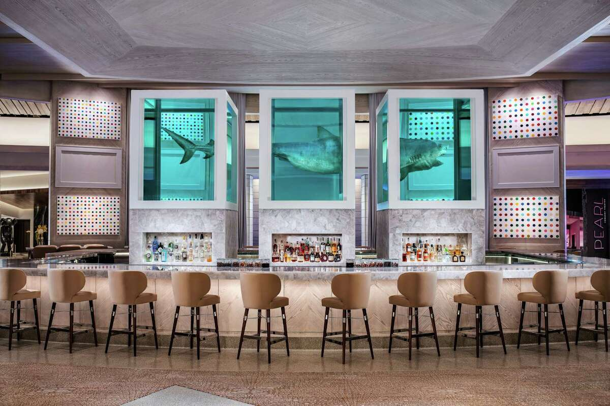 """The Palms Casino Resort in Vegas is undergoing a $620 million re-imagining of the property. The new casino center bar, Unknown, features Damien Hirst's iconic """"The Unknown (Explored, Explained, Exploded), an art piece of a 12-foot-long tiger shark divided into three sections suspended in formaldehyde."""