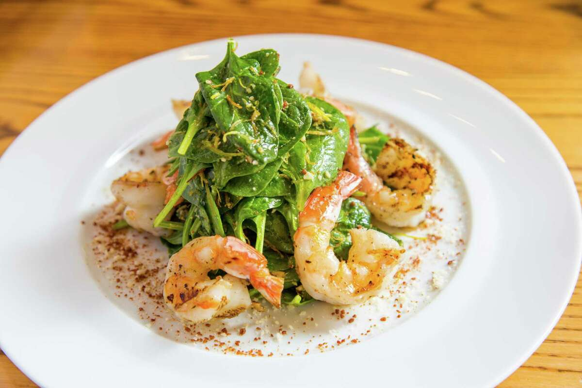 Baby spinach with grilled shrimp at Nobu Houston at the Galleria.