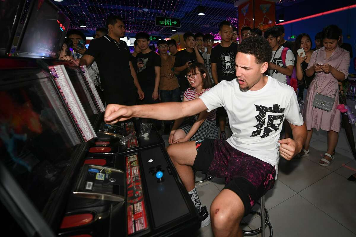 NBA player Klay Thompson of the Golden State Warriors plays arcade games with fans on June 26, 2018 in Zhengzhou, China. (Photo by DI YIN/Getty Images)