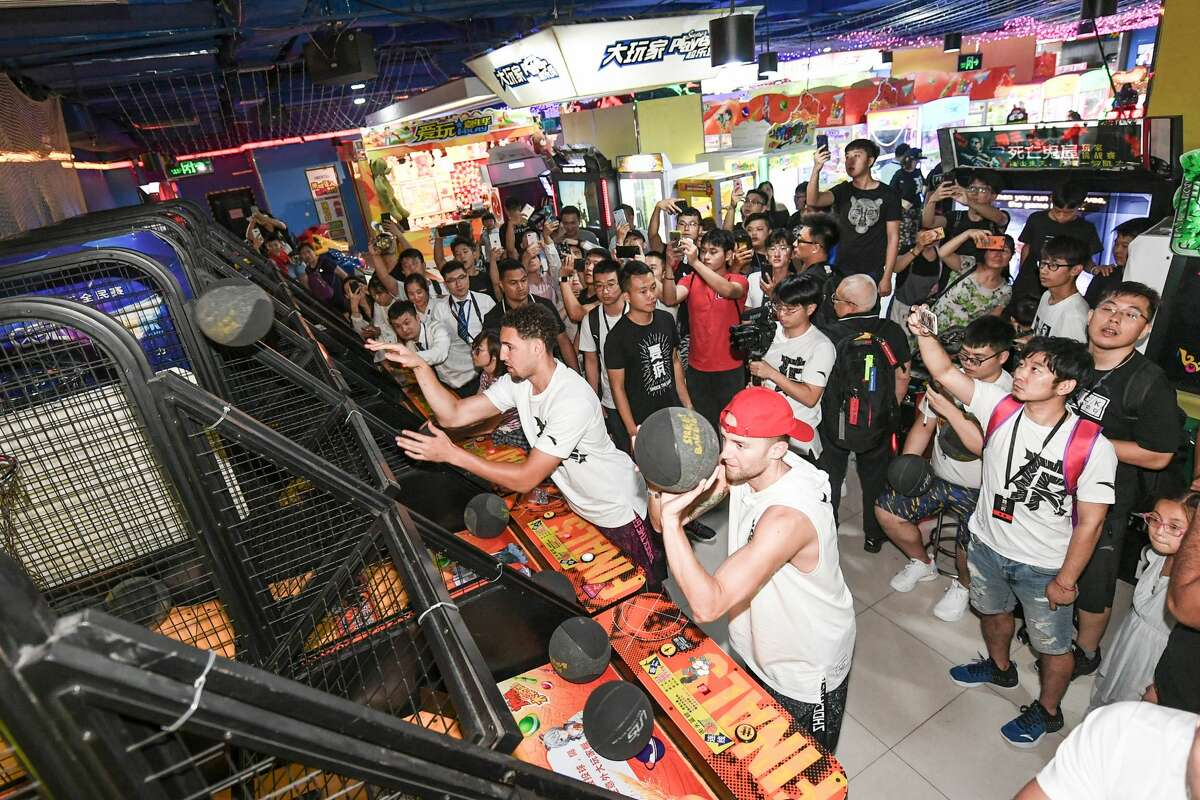 NBA player Klay Thompson of the Golden State Warriors plays arcade games with fans on June 26, 2018 in Zhengzhou, China.