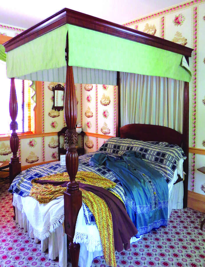 A poster bed in the Stephenson House showing some of the bed curtains.