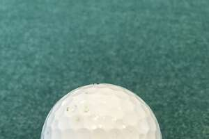 Joe Laughlin imprinted golf balls with his father's nickname.