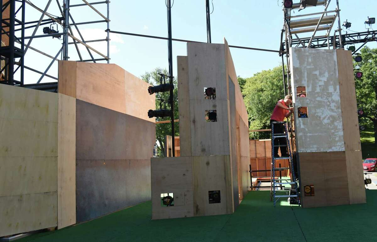 Crew members are busy setting up the stage for Damn Yankees on the Park Playhouse stage in Washington Park on Monday, June 25, 2018 in Albany, N.Y. (Lori Van Buren/Times Union)