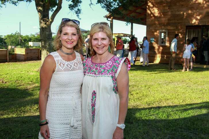 """Elizabeth Edwards, left, and Amy Krasner at Recipe for Success's second annual """"Chefs in the Field"""" dinner at Hope Farms."""