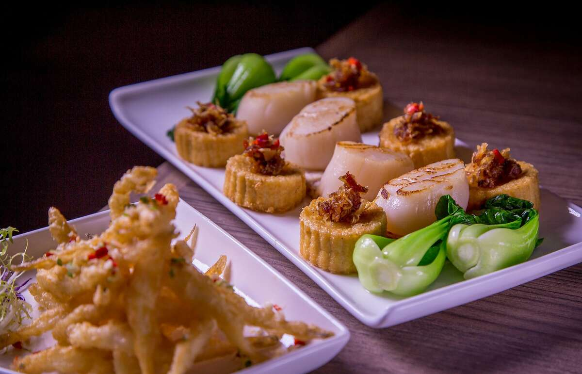 """Seared Scallops with X.O. sauce and the crispy White Bait """"Wuxi Style"""" at Crystal Jade in San Francisco, Calif., is seen on Friday, January 9th, 2015."""