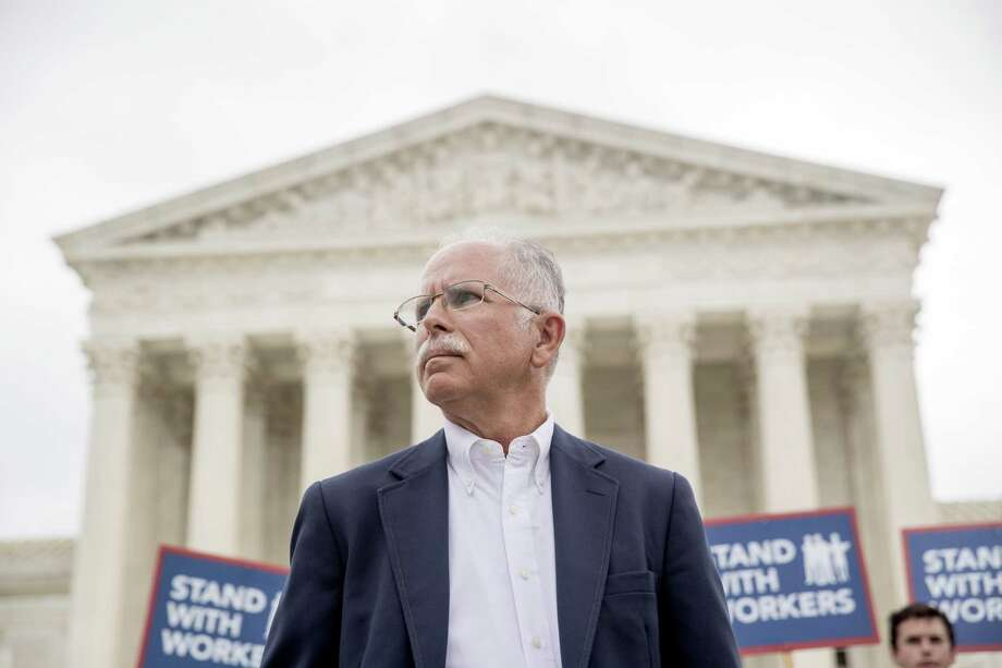 Plaintiff Mark Janus stands outside the Supreme Court after the court rules in a setback for organized labor that states can't force government workers to pay union fees, Wednesday, June 27, 2018, in Washington. Photo: Andrew Harnik / Associated Press / Copyright 2018 The Associated Press. All rights reserved