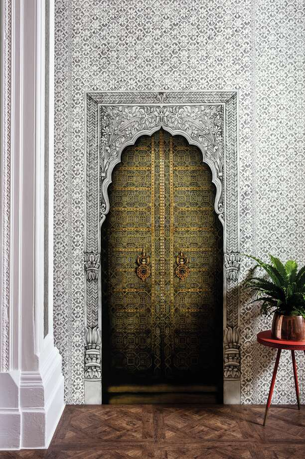 Designer Martyn Lawrence Bullard's Bahia gold and stone-colored doorway panel for Cole & Son brings the beauty of Marrakesh to your home. Inspired by Queen Victoria and Prince Albert's palatial holiday home, Osborne House, it includes elegant Jali fretwork with lace-like masonry painstakingly drawn and painted by hand. $896 per roll; Design House Photo: Design House / IP FULLY PROTECTED