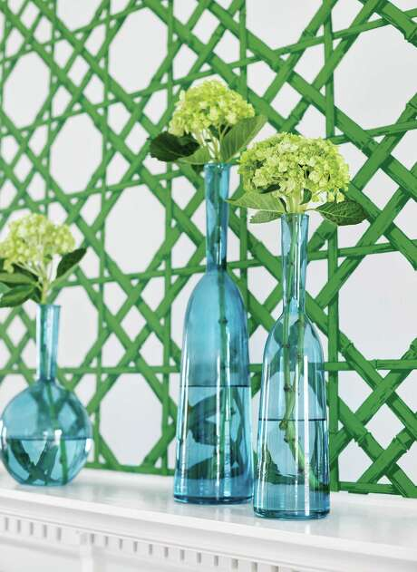 Cane wallcovering:Thibaut?s Cyrus Cane wallcovering will make any room feel just a little bit more like summer. Get it in this emerald green, or one of six others (navy, grey, coral, turquoise, gold or beige).