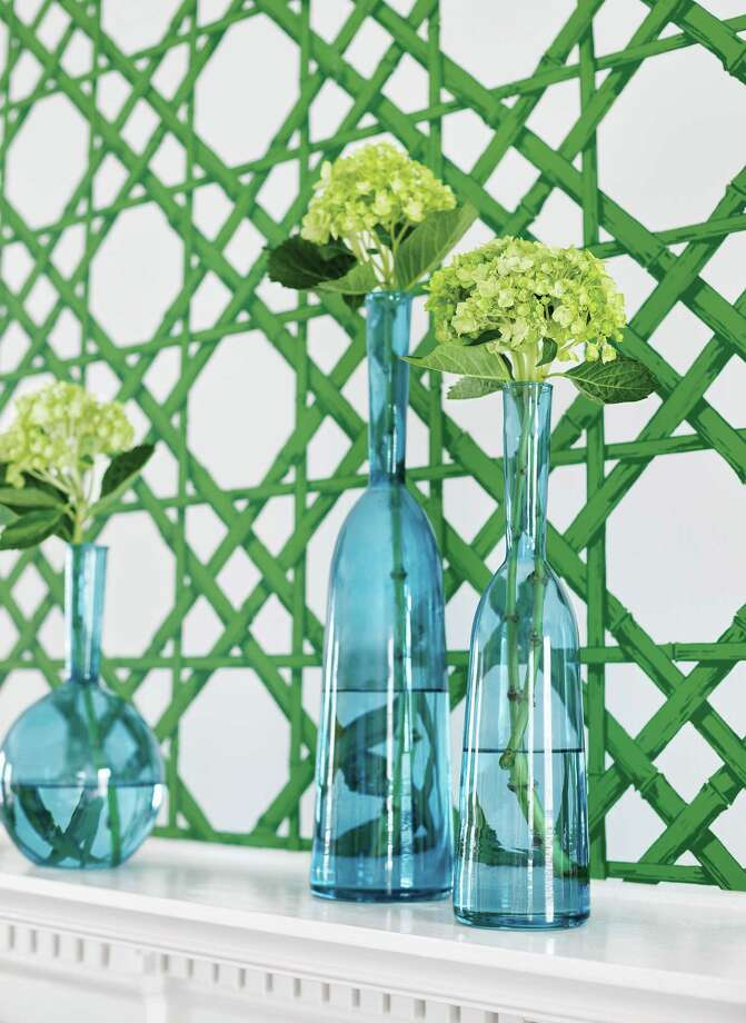 Cane wallcovering:Thibaut?s Cyrus Cane wallcovering will make any room feel just a little bit more like summer. Get it in this emerald green, or one of six others (navy, grey, coral, turquoise, gold or beige). Photo: Thibaut / Kip Dawkins Photography