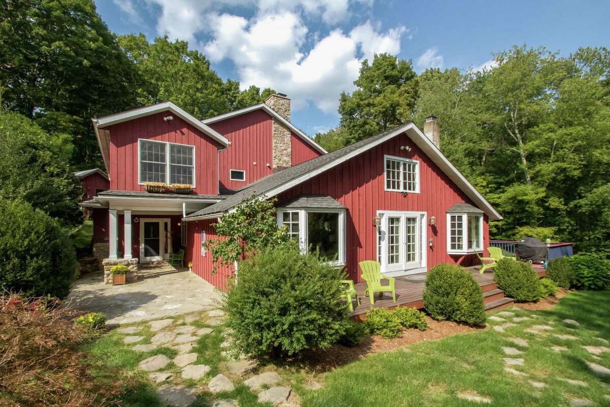 A landmark property at 808 Ridgefield Road was once a horseback riding camp for girls and is now an eight-room rustic yet modernized residence.