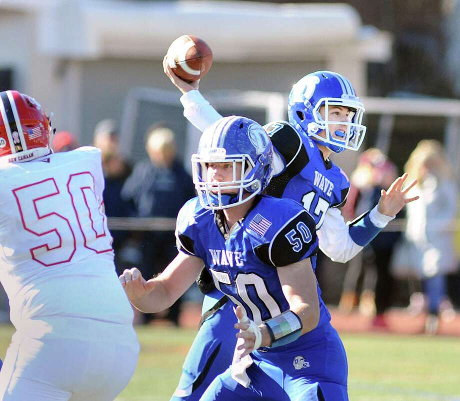 At right, Darien quarterback Peter Graham throws during the 2017 Turkey Bowl high school football game between Darien High School and New Canaan High School at Boyle Stadium last season. Photo: Bob Luckey Jr. / Hearst Connecticut Media / Greenwich Time