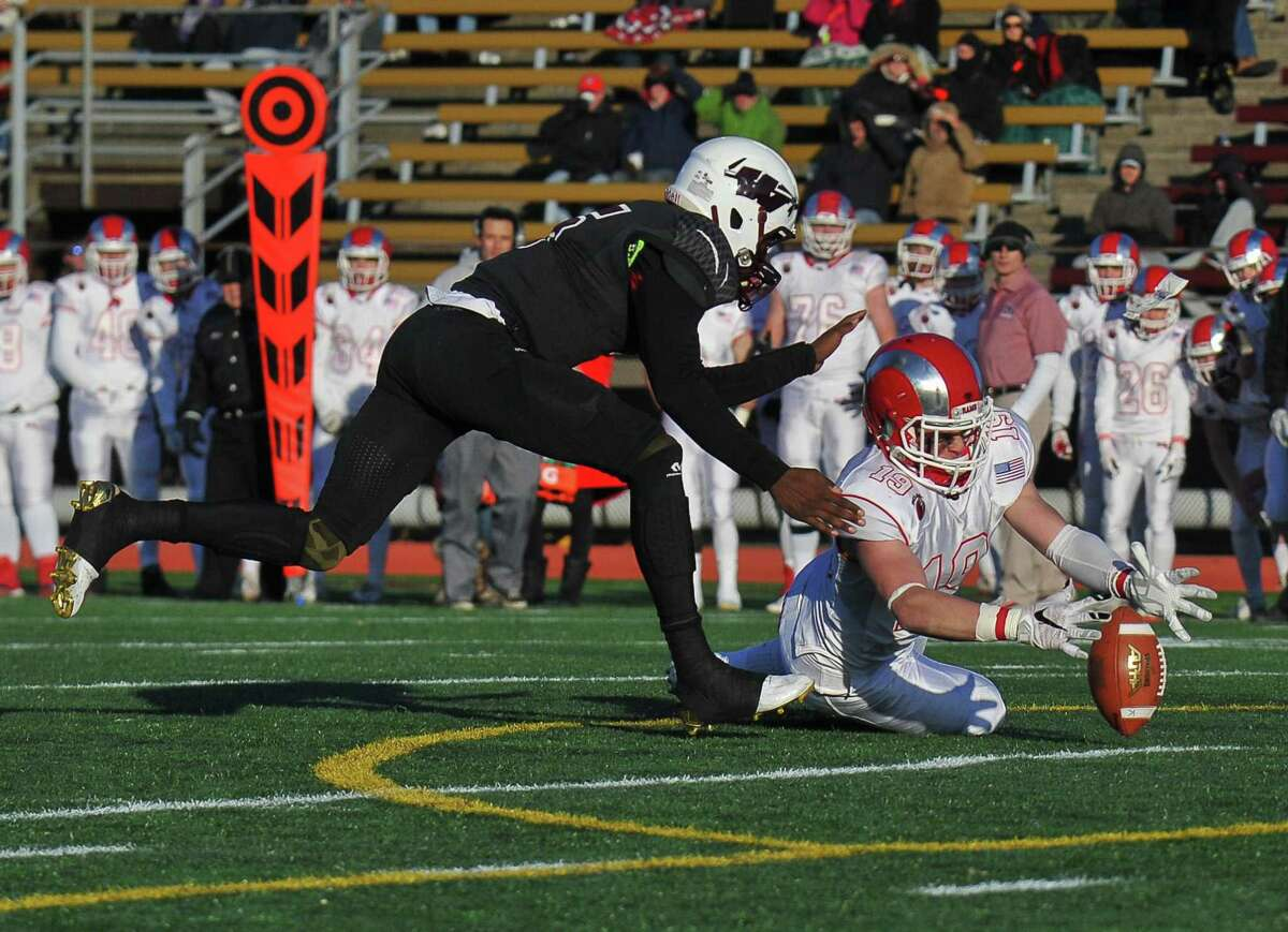 Garrett Braden of the New Canaan Rams recovers a fumble during the Class L State Championship Game against the Windsor Warriors as a sophomore.