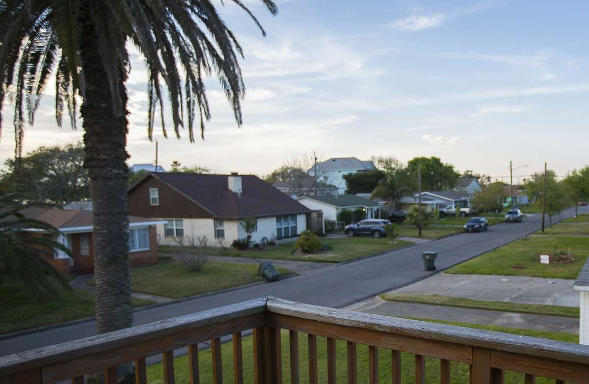 Julia Hatcher's street seen from the second floor balcony of her raised home on Campbell Lane, Wednesday evening. Hatcher raised her home after it filled with six feet of water during Hurricane Ike. It still sits as one of the few raised homes on the block.