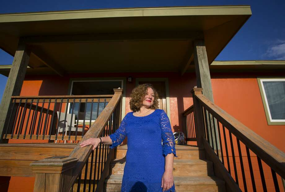Julia Hatcher, a Galveston attorney, raised her home on Campbell Lane after Hurricane Ike. The house still stands as one of the few homes elevated on the street, all of which took on six to eight feet of water. Photo: Mark Mulligan/Houston Chronicle