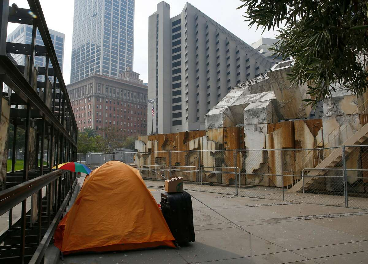 View of Justin Herman Plaza looking through the Abraham Lincoln Brigade memorial--painted steel, onyx, concrete, olive trees/2008--and Vaillancourt Fountain with homeless tent in the middle onTuesday, October 17, 2017, in San Francisco, Calif.