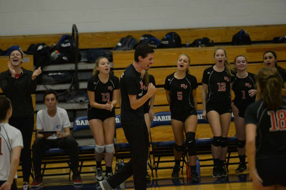 New Canaan girls volleyball coach Kevin Marino reacts after a point last season. Marino recently was named head volleyball coach at Chelsea Piers.