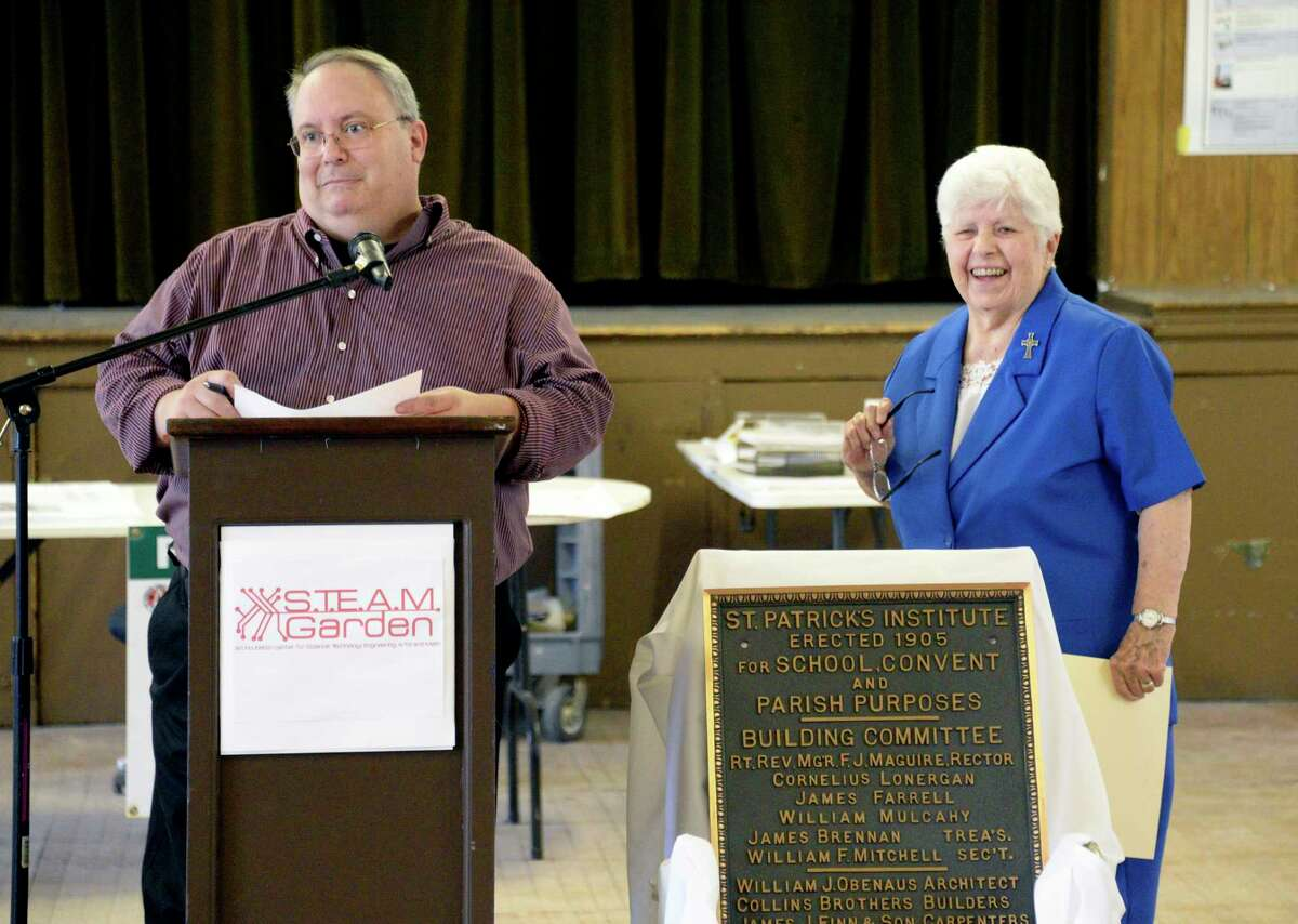 Central Avenue Business Improvement District executive director Anthony Capece, left, and former principal Sister Rita Carr speak during a ground-breaking event for converting the former St. Patrick's School on Central Avenue into a STEAM incubator Wednesday June 27, 2018 in Albany, NY. When complete, the multi-functional space will consist of a blend of educational classrooms, a historic restorations laboratory, business incubation, and co-work spaces. (John Carl D'Annibale/Times Union)