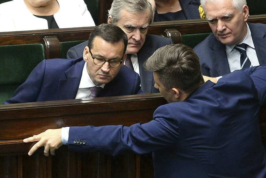 Prime Minister Mateusz Morawiecki (left) confers in parliament during a debate on the Holocaust law. Photo: Alik Keplicz / Associated Press