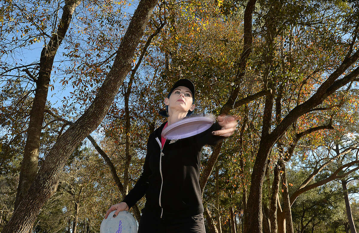 Christina Linthicum of Nederland first started playing disc golf with her brothers over a decade ago. She turned pro 7 years ago and has been competing in tournaments ever since. Linthicum practices almost daily on the course in Klein Park in Beaumont. Photo taken Wednesday, January 24, 2018 Kim Brent/The Enterprise