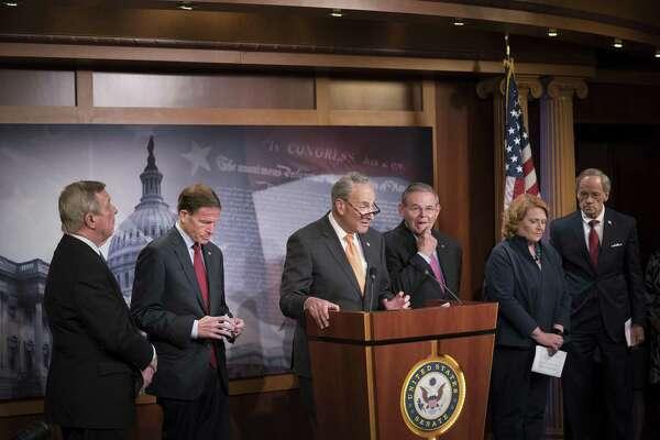Senate Minority Leader Chuck Schumer (D-N.Y.) speaks at a news conference on immigration on Capitol Hill in Washington, June 27, 2018. From left: Sens. Dick Durbin (D-Ill.), Richard Blumenthal (D-Conn.), Schumer, Robert Menendez (D-N.J.), Heidi Heitkamp (D-N.D.) and Tom Carper (D-Del.). (Erin Schaff/The New York Times)